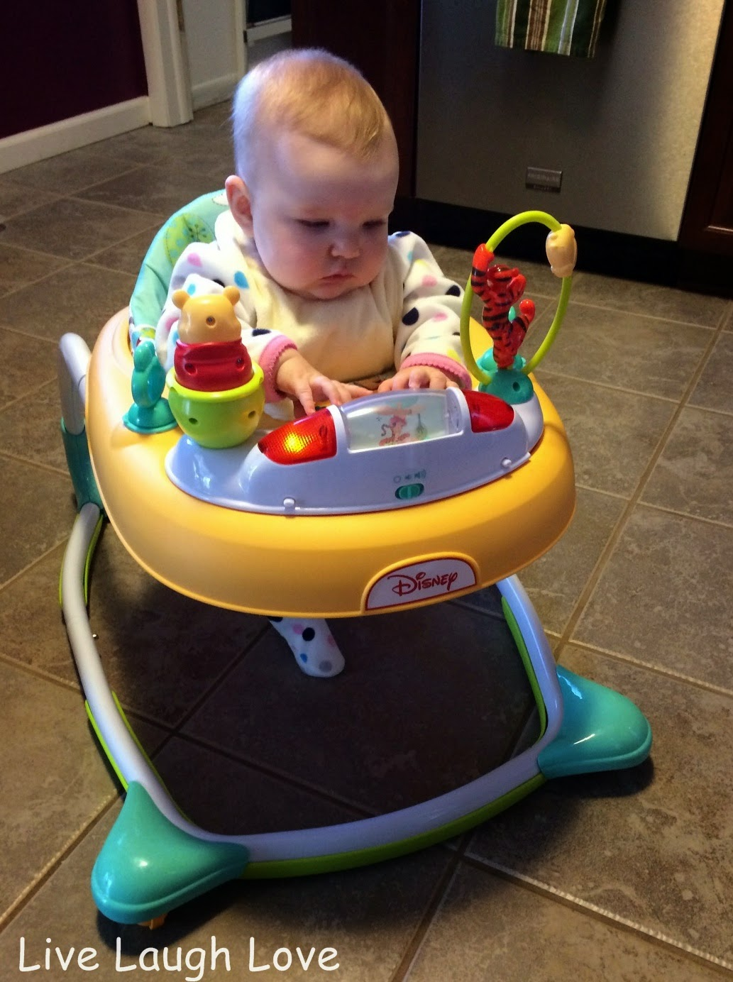Disney Walker Pooh - Kyla in her new winnie the pooh dots hunny pots walker she is a little to young to make it walk but as she gets older i think she will be