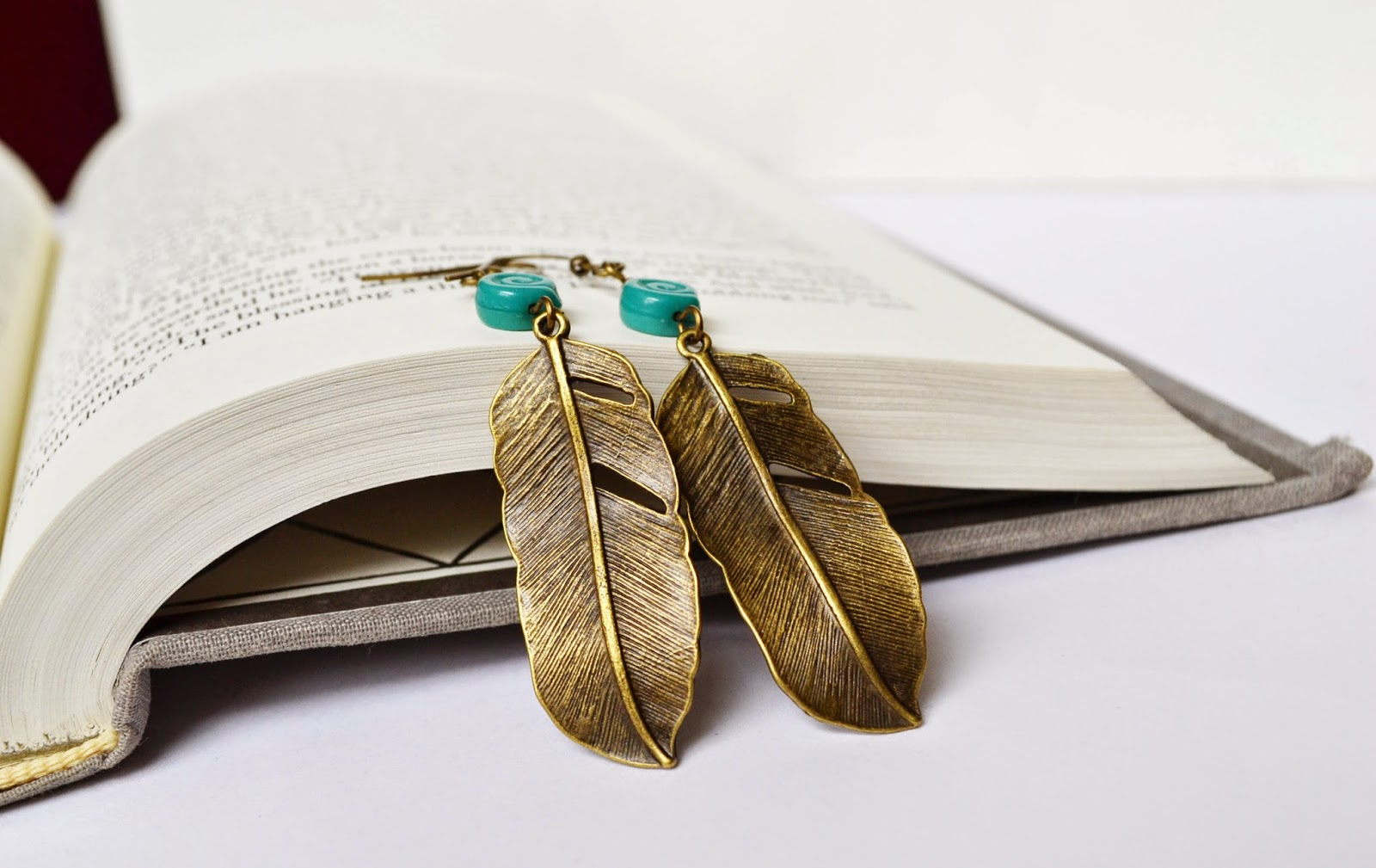 https://www.etsy.com/listing/107378903/metal-feather-earrings-swirl-bead-brass?ref=shop_home_active_23