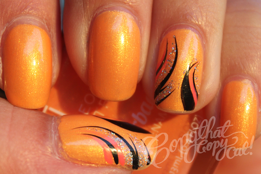 Orange and Black Nail Designs http://www.copythatcopycatnails.com/2012/07/face-of-australia-orange-you-glad-you.html