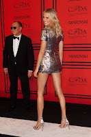 Karolina Kurkova shows off her curves in a hot silver playsuit