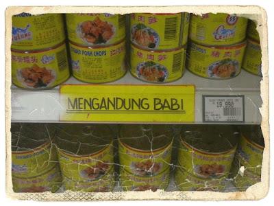 tin mengandungi daging babi