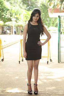 Deepa Sannidhi Looks Smart and Beautiful in Black Short Dress High Heels