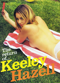 Keeley Hazell topless on a towel layinh in  grass at a park