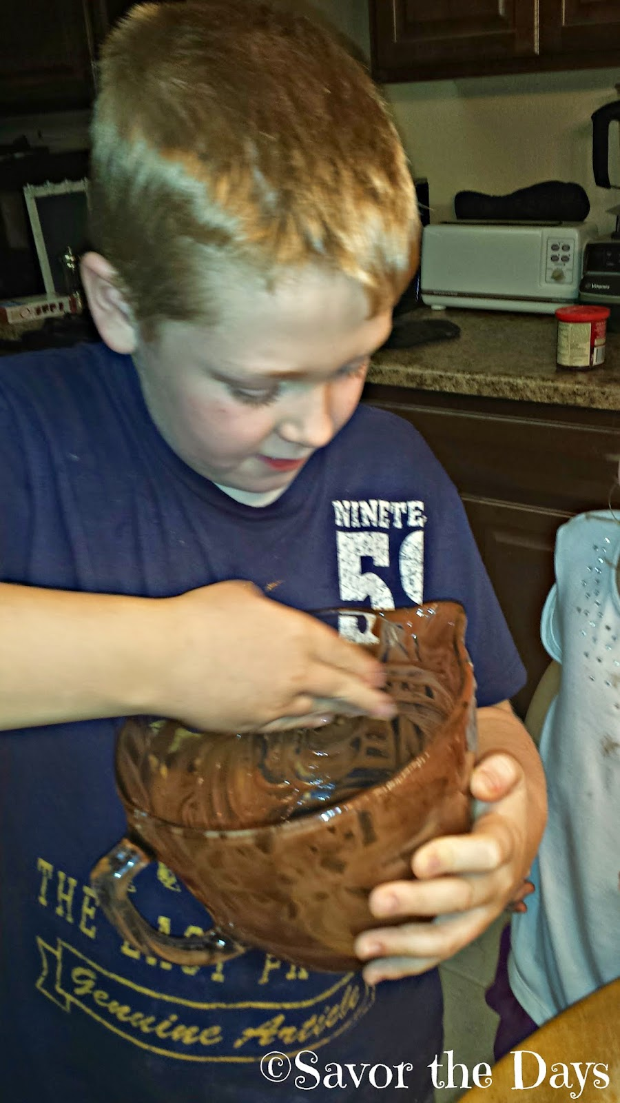 boy making cupcakes