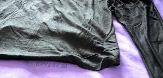 Close-up of the black cold shoulder long sleeve crop top from SheIn.