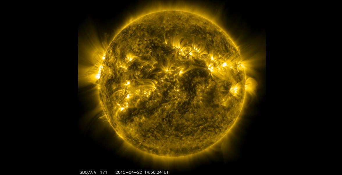 Bright spots and illuminated arcs of solar material hovering in the sun's atmosphere highlight what's known as active regions on the sun, in this image from NASA's Solar Dynamics Observatory, captured on April 20, 2015. These are areas of intense and complex magnetic activity that can sometimes give rise to solar eruptions such as solar flares and coronal mass ejections. Credits: NASA/SDO