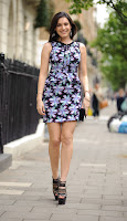 Kelly Brook leggy in front of her home