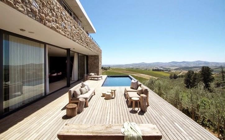 Casa hillside fachada de piedra y madera gass architecture arquitexs - Casas prefabricadas madera y piedra ...