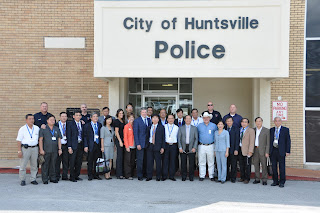 A delegation of 20 Corporals from Vietnam met with police officials in Huntsville.