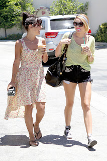 Miley Cyrus and her friend enjoying a refreshing Drink from Starbucks