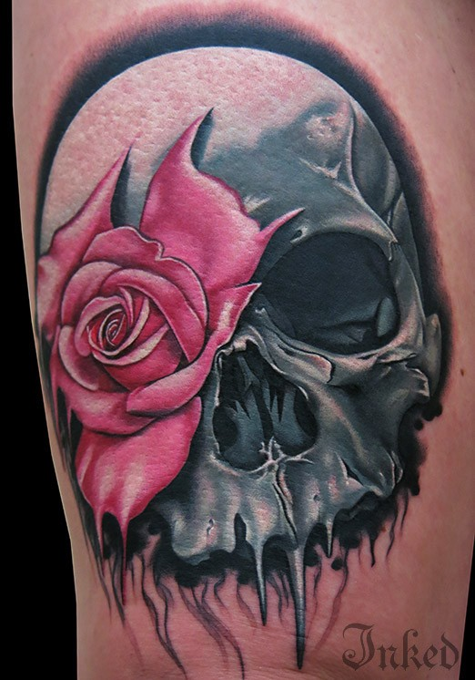 Grey skull with pink rose tattoo