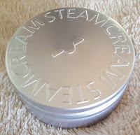 Steamcream in silver tin container