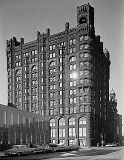 The Metropolitcan Building in 1960, 12 stories of dark stone and castle-like towers