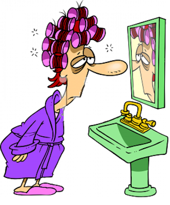 tired woman looking at the mirror
