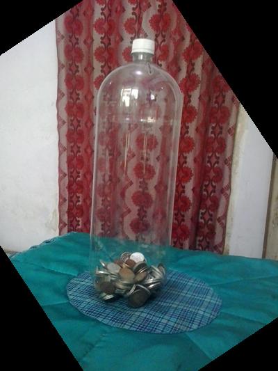 Mengumpulkan Receh Dalam Botol Bekas