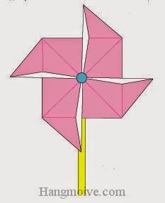 Bước 11: Hoàn thành cách xếp chong chóng bằng giấy. Giờ ta có thể thổi hoặc mang chong chóng ngược gió là nó sẽ quay.