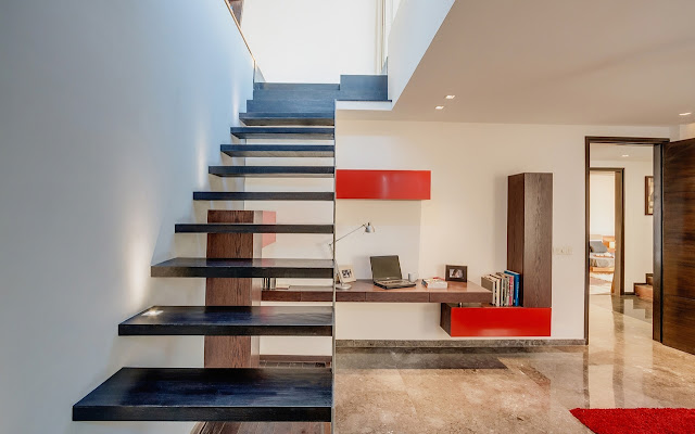 Picture of black modern wooden staircase without the railing