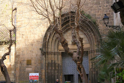 Gothic doorway of Santa Anna church inside the Barcelona Gothic Quarter