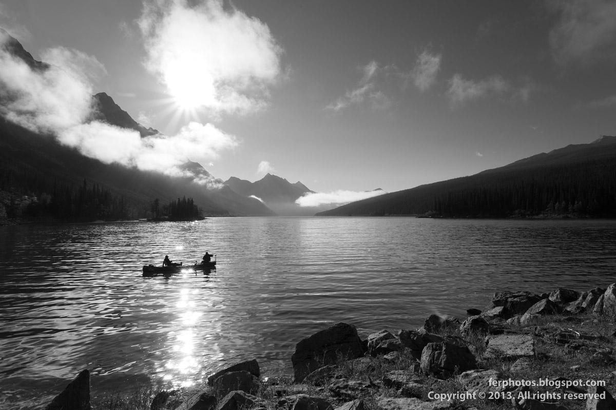 canoe in Lake Maligne black and white Jasper national park Canada Alberta Rocky Mountains