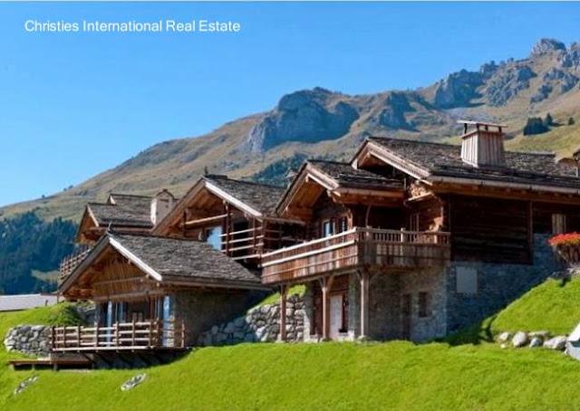 Chalet suizo de piedra y madera con aspectos rústicos tradicionales