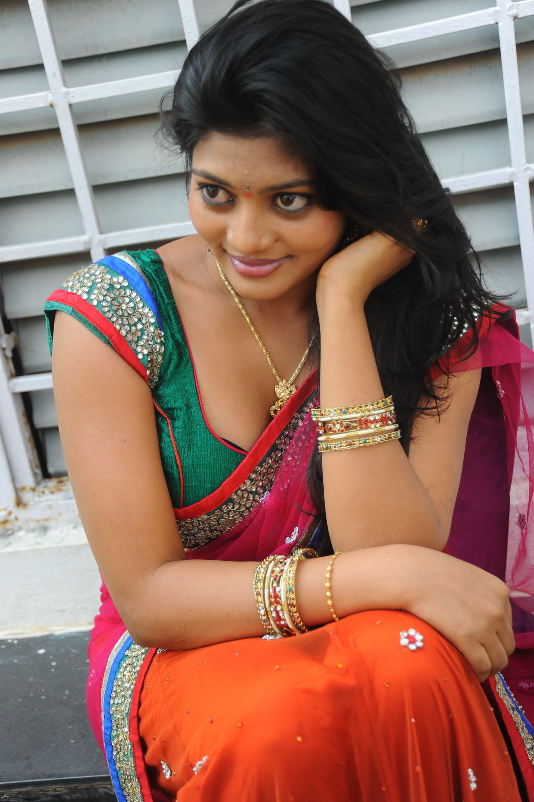 Soumya looks cute in Red Saree and Black Blouse