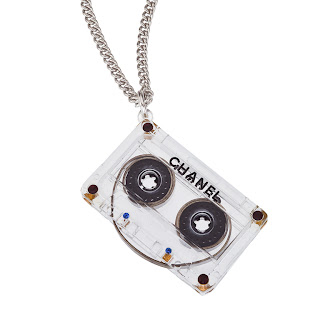 Modern Chanel clear cassette necklace with silver chain.