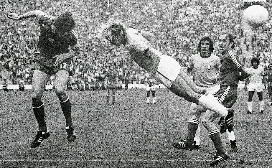 In this July 6, 1974 file photo, Deyna of Poland, left, heads the ball, while Brazil's Marinho challenges. Poland's Grzegorz Lato looks on, at right, during third place play-off in Munich, West Germany. On this day: Poland beats Brazil 1-0 to claim third place in the 1974 World Cup with Lato scoring the only goal, taking his tournament tally to 7.