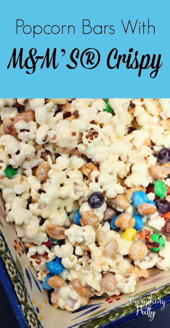 Popcorn bars with M&M'S® Crispy, peanuts, and popcorn. A delicious snack under 200 calories!