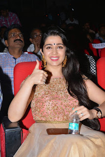 Actress Charmee Kaur Latest Pictures in Long Dress at Temper Movie Audio Launch  15