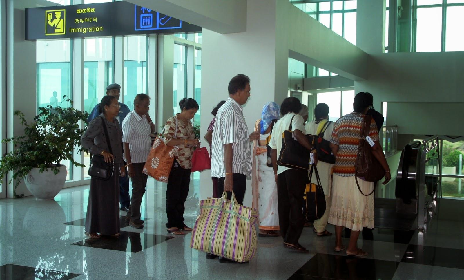 Mihin Lanka passengers on pilgrimage disembarking  at the MRIA terminal building from Varanasi