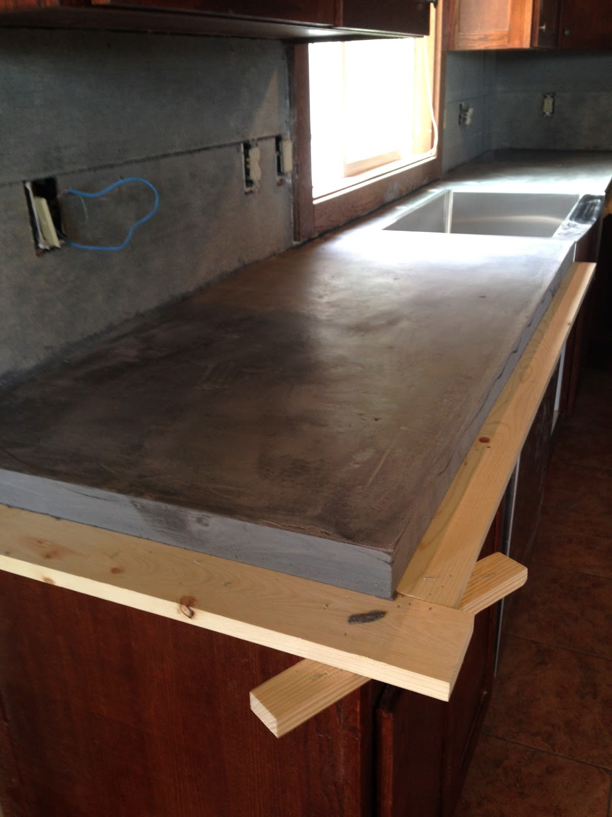 Diy concrete counters poured over laminate averie lane diy moment of truth taking off the forms solutioingenieria