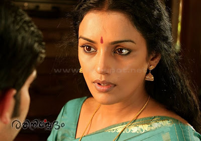 Swetha Menon hot sexy boobs showing on Rathinirvedam Remake film  Romancing with young actor and exposing very hot sexy pic