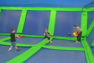Kids Playing Dodge Ball On Trampoline