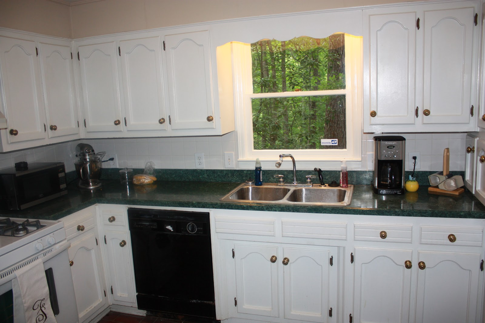 Green kitchen cabinets white countertops for Kitchen cabinets green