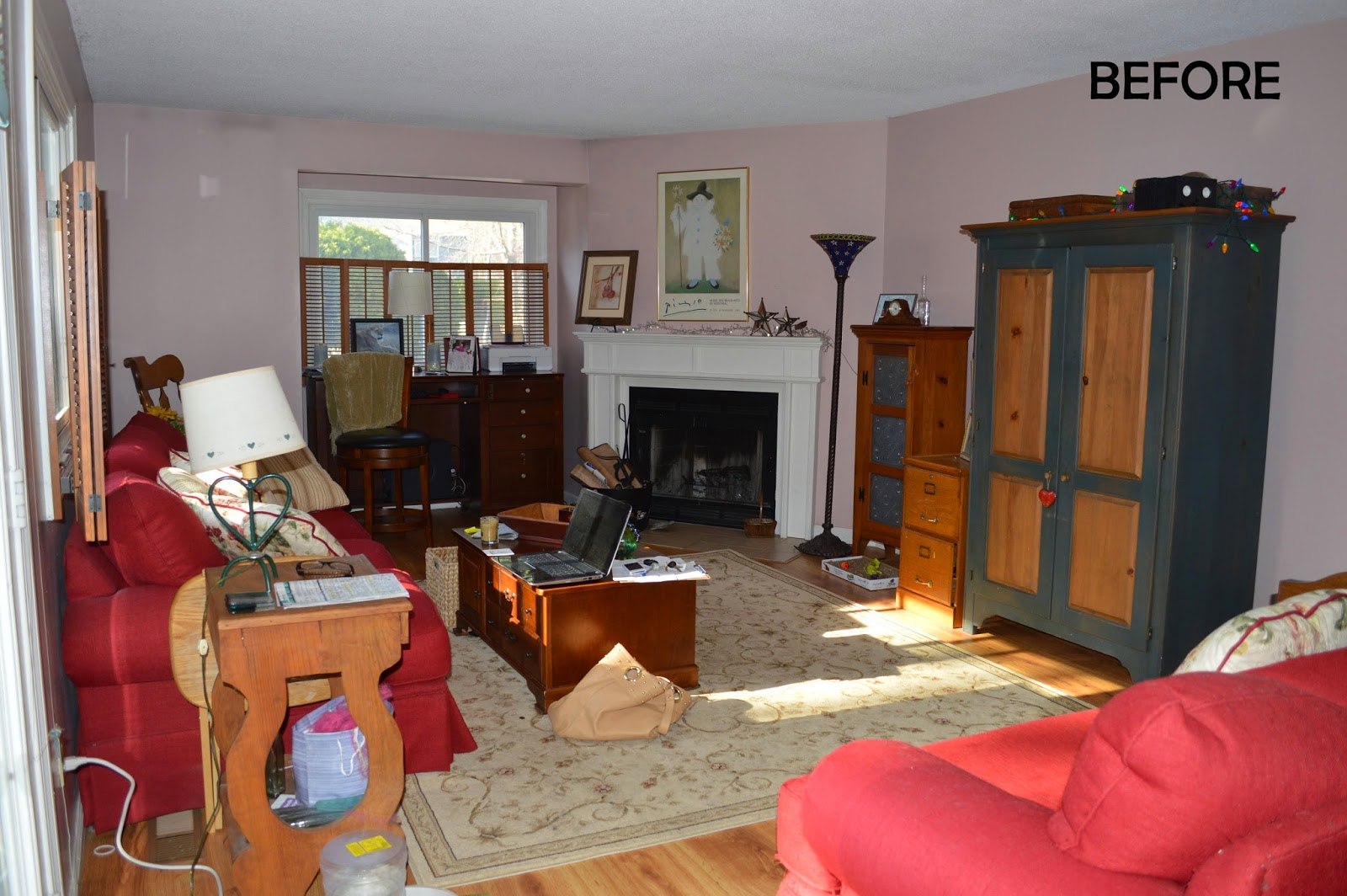 Pink walls with smoke damage up by the ceiling 80s country wood furniture bland tile in front of the fireplace too much clutter