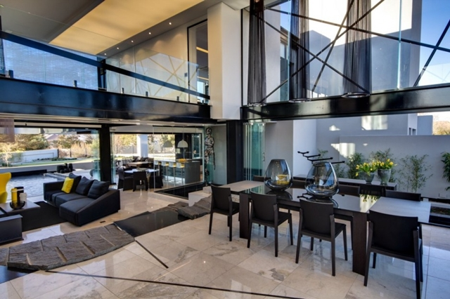 Photo of dinning room with living room in the background