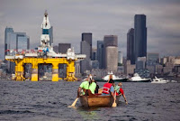 Members of the Duwamish Tribe protest against the Shell Oil Company's drilling rig Polar Pioneer as it arrives in Seattle, Washington, May 14, 2015. (Credit: Reuters/Matt Mills McKnight) Click to Enlarge.
