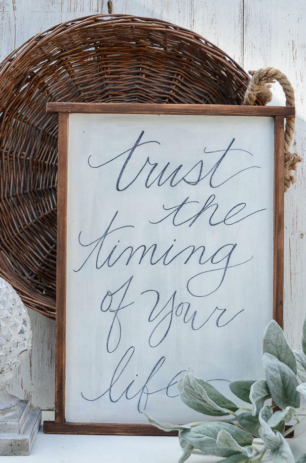 An unused board is transformed into a unique piece of wall art by handwriting a favorite quote.