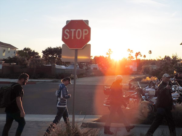 As the Carlsbad, California sun rises, Rutledge Wood and his friend Kyle Petty head out for the Charity Rider meeting