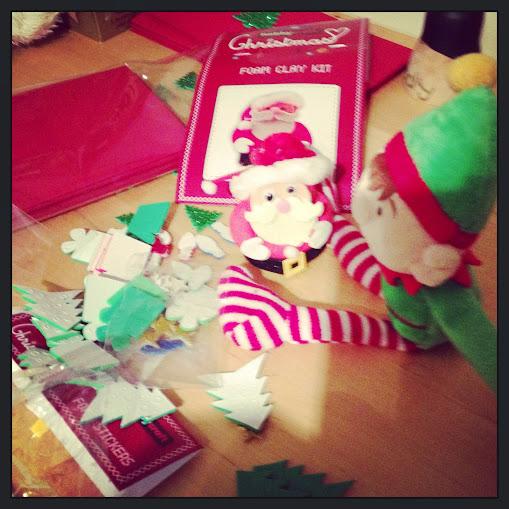 elf and foam Santa