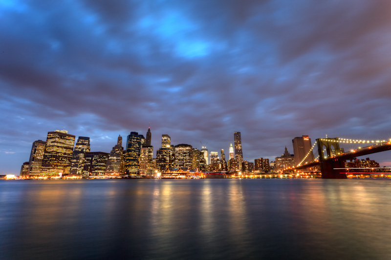 View of the Manhattan New York skyline at night from Brooklyn