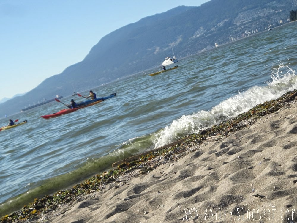 Kayakers in English Bay in Vancouver, from Kitsilano Beach