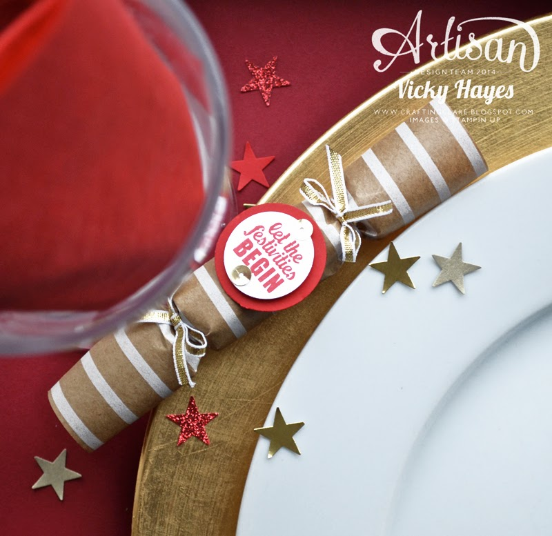 A table setting with handmade Christmas crackers and star confetti