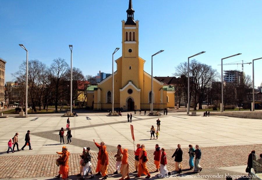 Hare Krishnas walking through Freedom Square, Old Town Tallinn