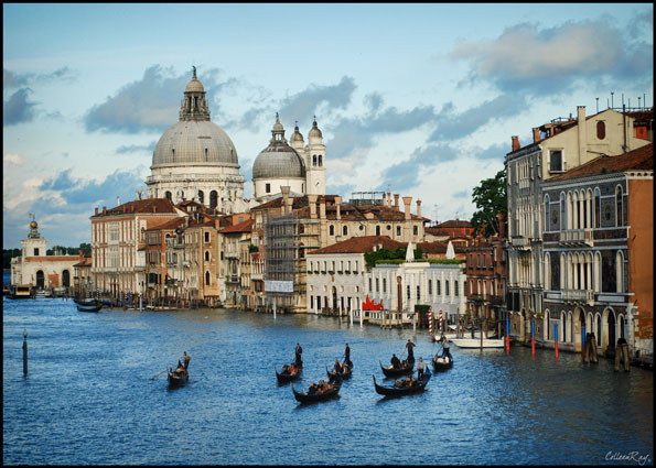Group of several gondoliers on Grand Canal, late in the day light, Venice