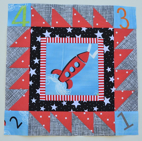 red black blue modern quilt block with rocket