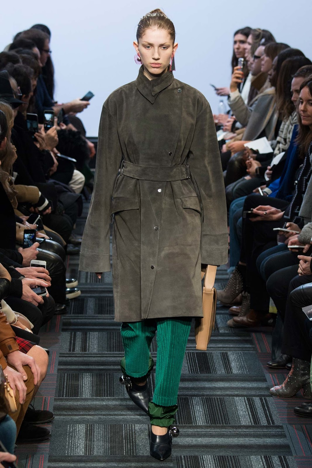 Trench coats as seen on a runway at JW Anderson Autumn/Winter 2015 via www.fashionedbylove.co.uk