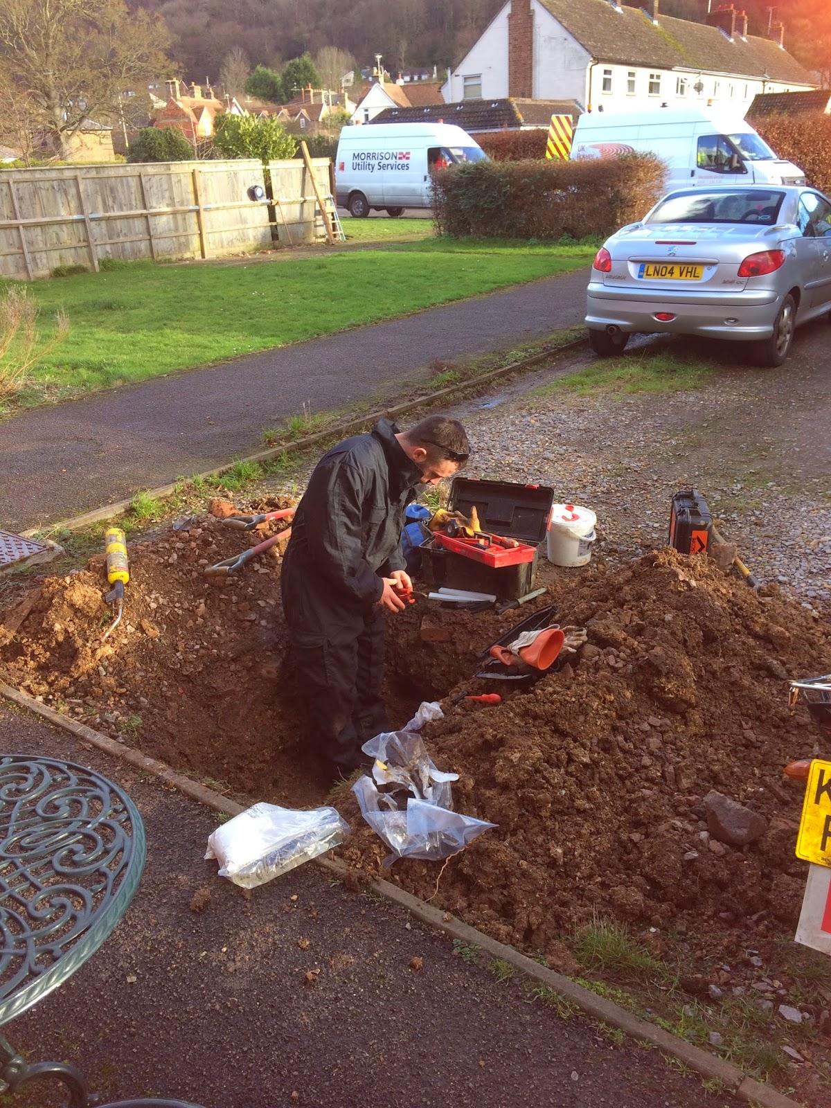 electricity man digging up driveway