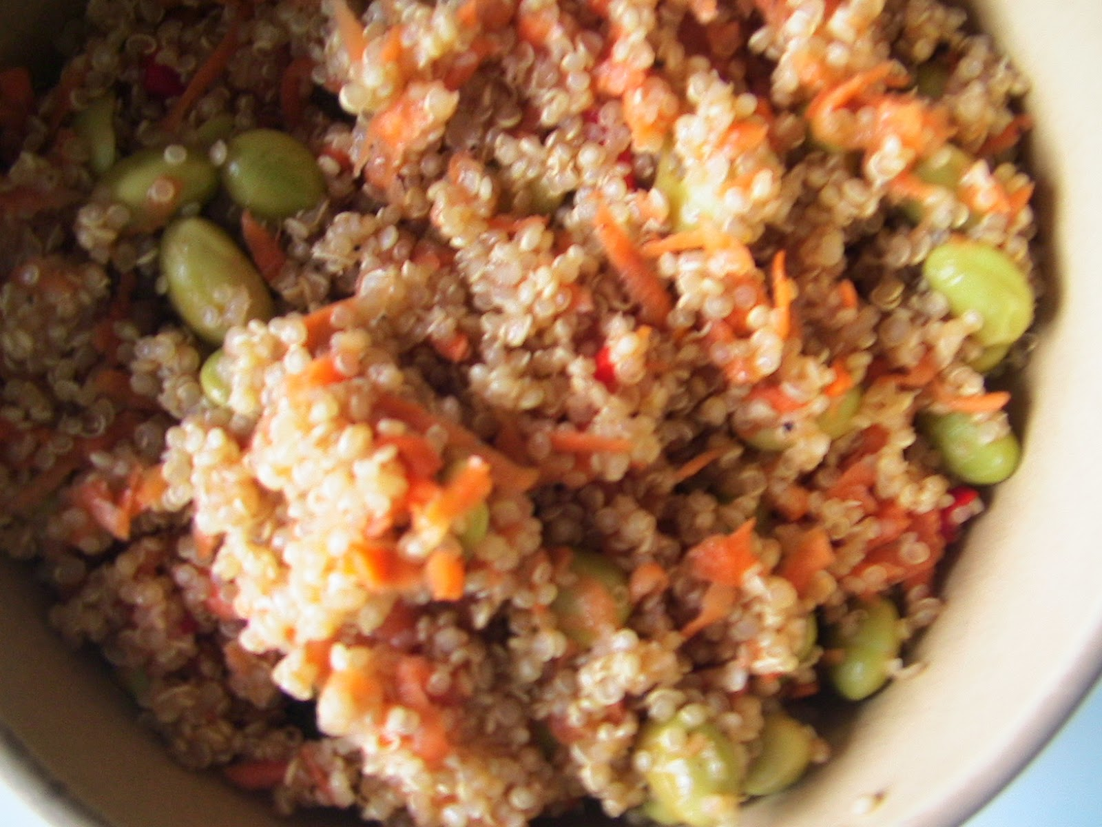 quinoa salad with edamame, grated carrot, and pomegranate dressing