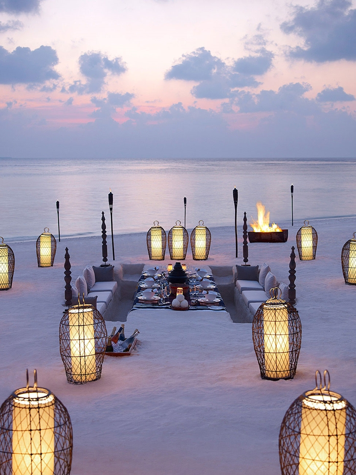 Dining set in the sand in Luxury Dusit Thani Resort in Maldives